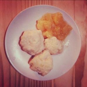 German potato dumplings with apple compote on a plate