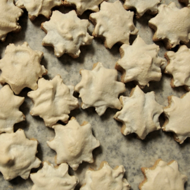 Cinnamon stars (Zimtsterne, German christmas cookies) on a baking tray