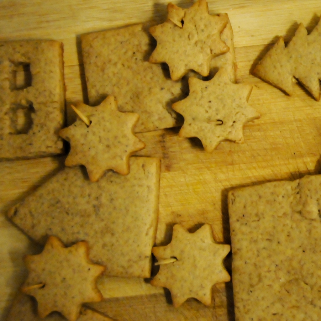 gingerbread cookies with a toothpick through the middle to create an opening to hang them on a tree