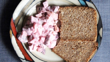 plate of red herring salad (Roter Heringssalat) with 2 slices of rye bread