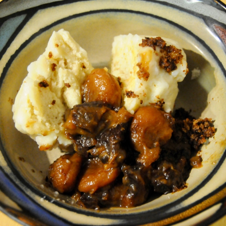 yeast dumplings on a plate with stewed dried fruits