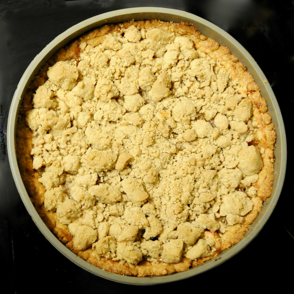 crumble cake fresh from the oven still in its springform tin