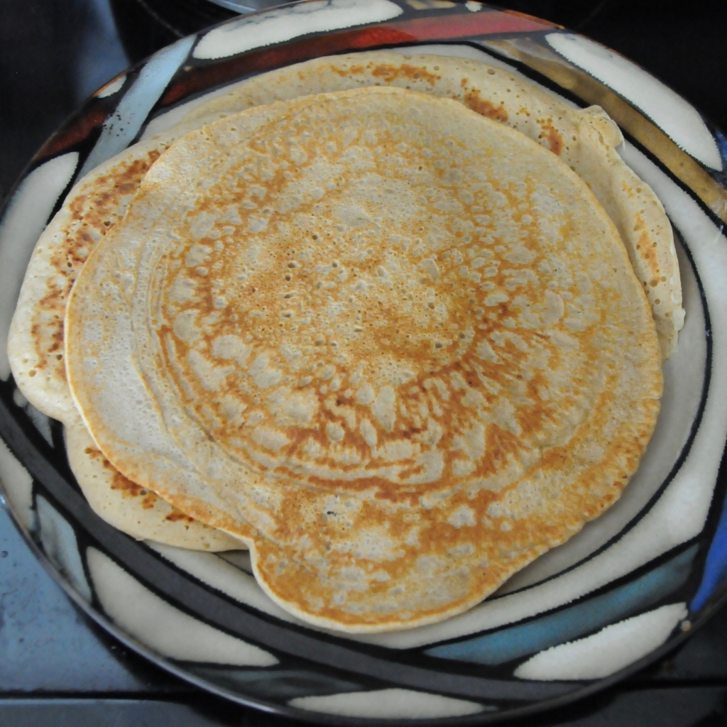 a plate with several pancakes on it