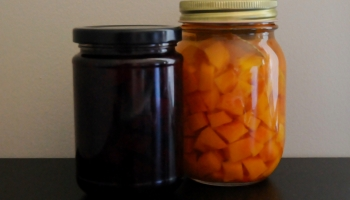 2 mason jars one with pickled red beets, one with pickled pumpkin