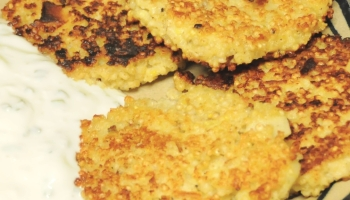 Parnsip and millet burgers on a plate with sour cream