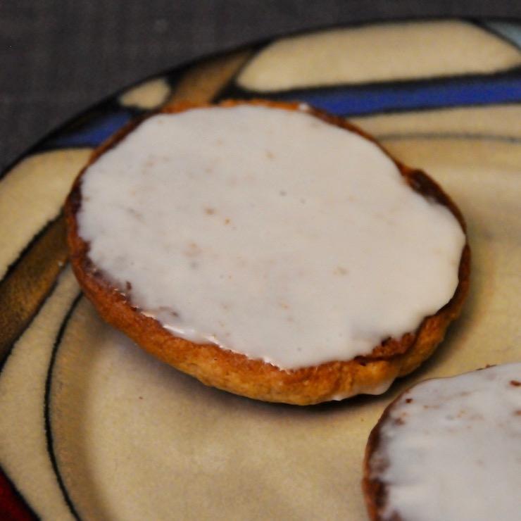 "plate with 2 ""Amerikaner"" (German cookies) on it"