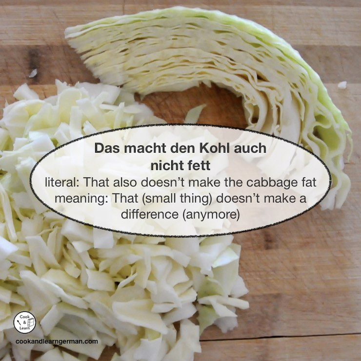 """Cabbage shredded and in parts, a bubble on top says: """"Das macht den Kohl auch nicht fett - literal: That also doesn't make the cabbage fat - meaning: That (small thing) doesn't make a difference (anymore)"""""""