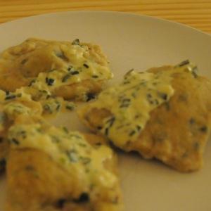 German dumplings (Maultaschen) filled with mushrooms and a cream sauce