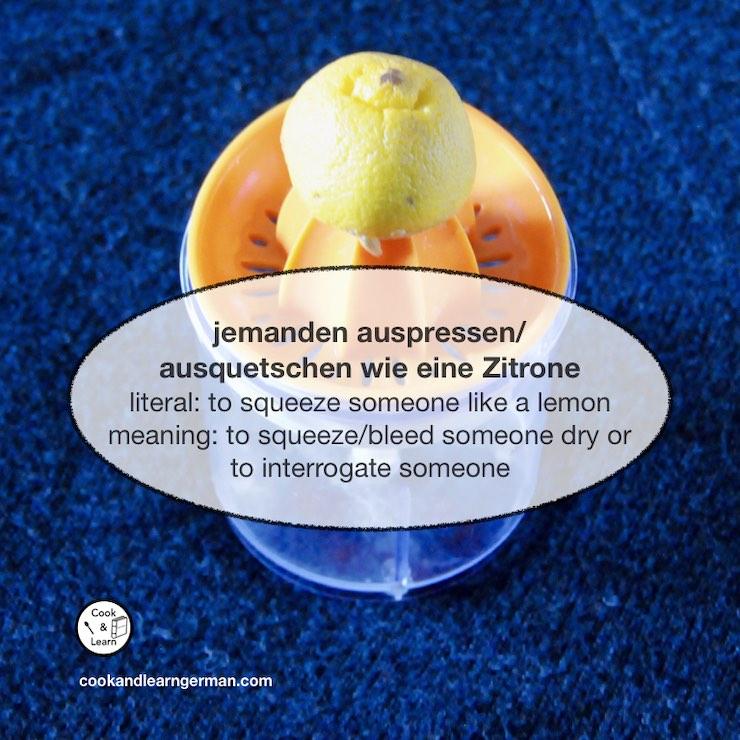 "Half a lemon on a citrus press, a speech bubble says: ""jemanden auspressen/ausquetschen wie eine Zitrone - literal: to squeeze someone like a lemon - meaning: to squeeze/bleed someone dry or to interrogate someone"""