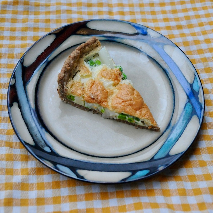 a slice of asparagus and pea cake on a plate
